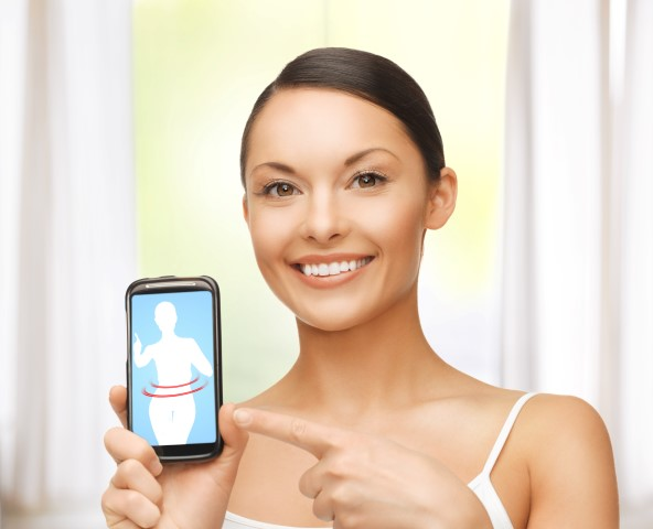 woman pointing at smartphone with application